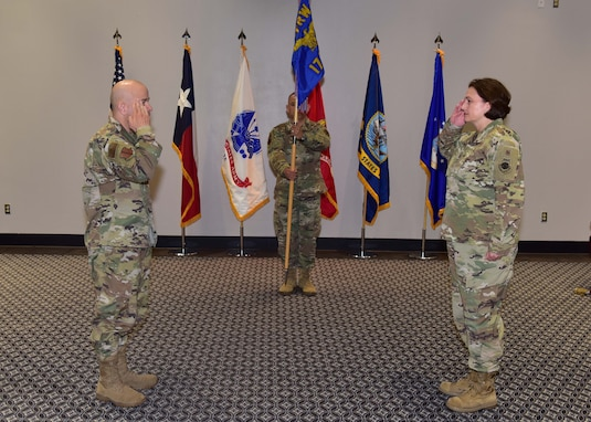 U.S. Air Force Col. Angelina Maguiness, 17th Training Group commander, assumes command from presiding official Col. Andres Nazario, 17th Training Wing commander, during the 17th TRG Change of Command ceremony on Goodfellow Air Force Base, Texas, June 18, 2020. Maguinness took over the group from Col. Thomas Coakley, former 17th TRG commander, who led the unit for the past two years. (U.S. Air Force photo by Staff Sgt. Chad Warren)