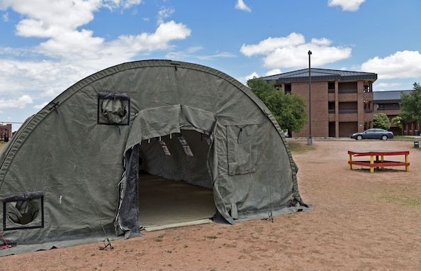 An empty medical tent is temporarily set up outside the Marine Corps Detachment on Goodfellow Air Force Base, Texas, June 17, 2020. The tent was used to combat COVID-19 with containment efforts. (U.S. Air Force photo by Airman 1st Class Michael Bowman)