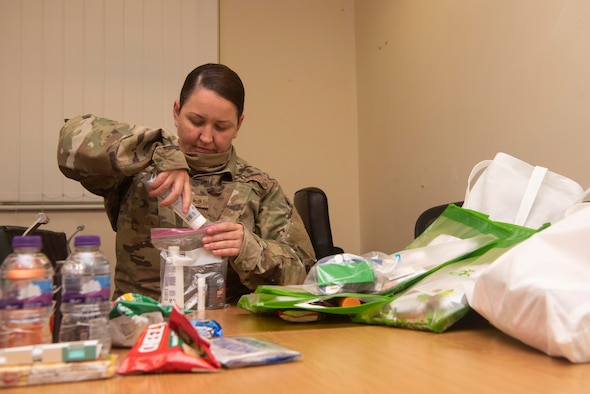 Master Sgt. Aisling Loftus, 100th Force Support Squadron postal superintendent, assembles a care package of hygiene items at RAF Mildenhall, England, June 15, 2020. Loftus spearheaded an initiative led by the Top-3 committee to collect hygiene items, snacks, and money for local healthcare workers. (U.S. Air Force photo by Airman 1st Class Joseph Barron)