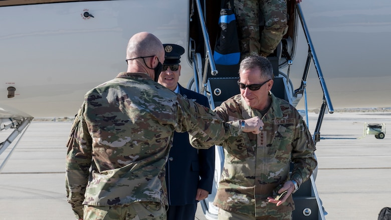 Maj. Gen. Christopher Azzano, Air Force Test Center commander, greets Air Force Chief of Staff Gen. David Goldfein at Edwards Air Force Base, California, June 17. (Air Force photo by Giancarlo Casem)