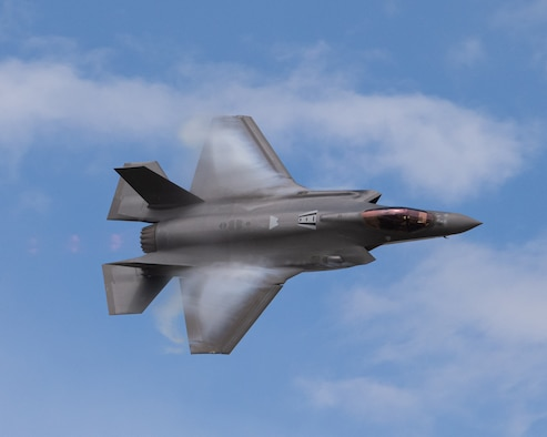 "Capt. Kristin Wolfe, F-35A Lightning II Demonstration Team pilot, performs the ""dedication pass"" maneuver during practice at Hill Air Force Base, Utah, June 16, 2020. The maneuver is intended to provide an aerial salute to service members past and present. (U.S. Air Force photo by Capt. Kip Sumner)"