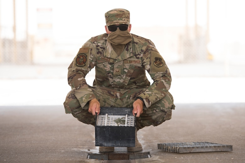 U.S. Air Force Senior Airman Ryan Disher, a vehicle operator assigned to the 379th Expeditionary Logistics Readiness Squadron, displays his team's winning submission in the U.S. Air Forces Central Command Spark Tank competition at Al Udeid Air Base, Qatar, June 13, 2020.