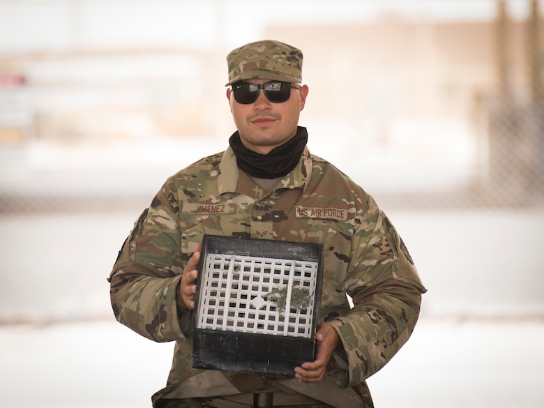 U.S. Air Force Senior Airman Fernando Jimenez, a vehicle operator assigned to the 379th Expeditionary Logistics Readiness Squadron, displays his team's winning submission in the U.S. Air Forces Central Command Spark Tank competition at Al Udeid Air Base, Qatar, June 13, 2020.