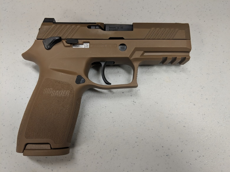 The Air Force Security Forces Center, in partnership with the Air Force Small Arms Program Office, has begun fielding the new M18 Modular Handgun System to Security Forces units. (U.S. Air Force photo by Vicki Stein)