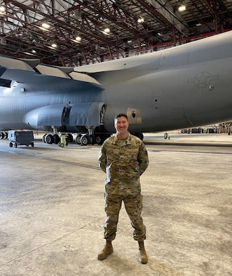 U.S. Air Force Tech. Sgt. Christopher Titus, 439th Maintenance Squadron airlift and special missions aircraft maintenance specialist, stands in front of a C-5M Super Galaxy on Westover Air Reserve Base, Massachusetts. Titus worked to put the aircraft back in the skies after Westover's flying operations ceased for more than 60 days. (Courtesy photo)