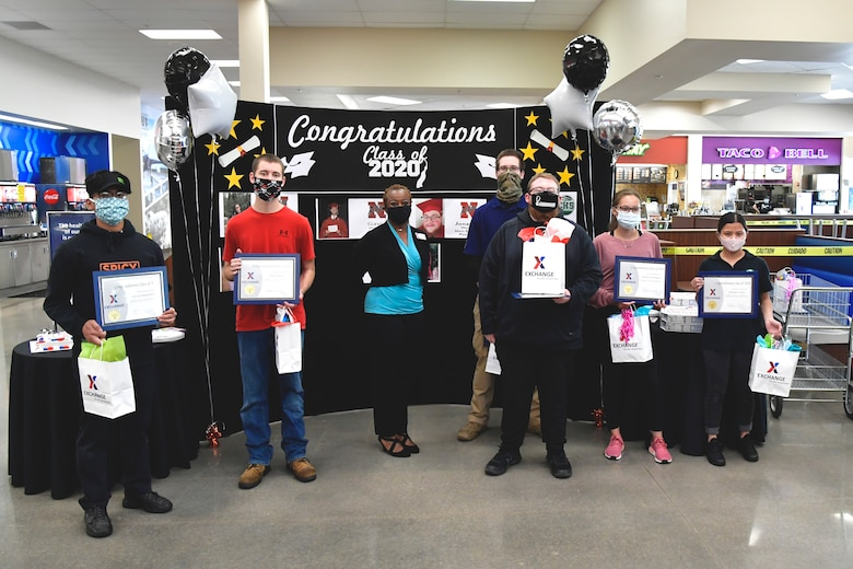 Melanie White, AAFES general manager, and seven student employees pose for a group photo with their recognition certificates.