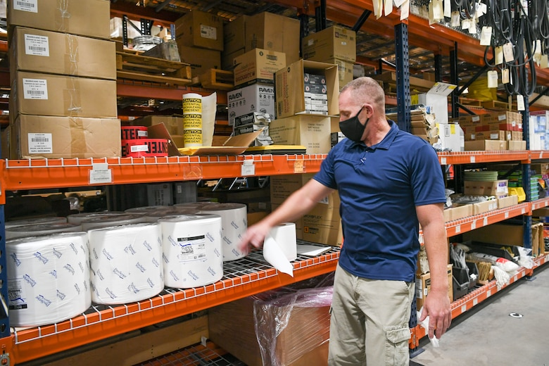 Brad Reed, 309th Maintenance Support Group material inventory center supervisor, browses the shelves of additional cleaning and protective supplies the group ordered due to COVID-19.
