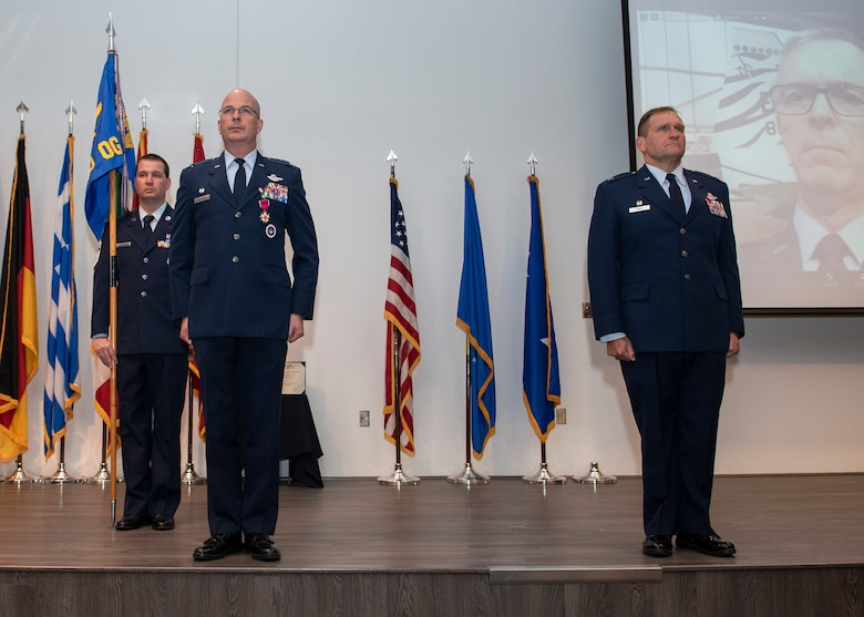 Driggers and Haas stand at attention during change of command ceremony