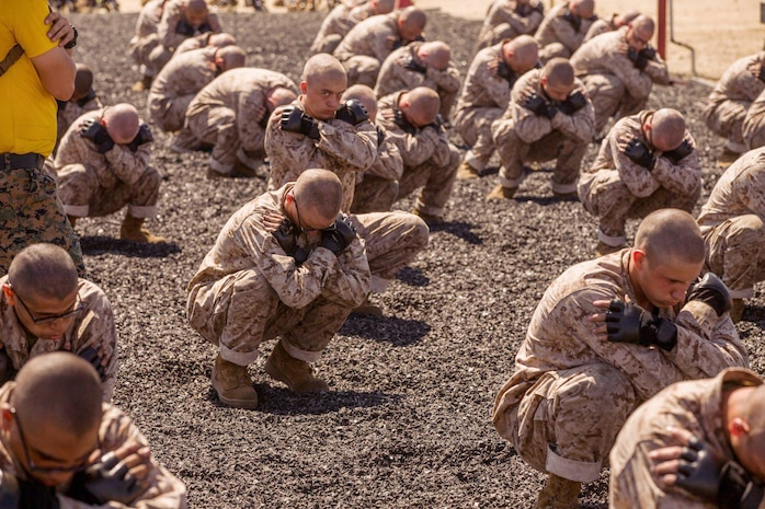 Recruits with Hotel Company, 2nd Recruit Training Battalion, conduct a back breakfall during a Marine Corps Martial Arts practice session at Marine Corps Recruit Depot, San Diego, June 15, 2020.