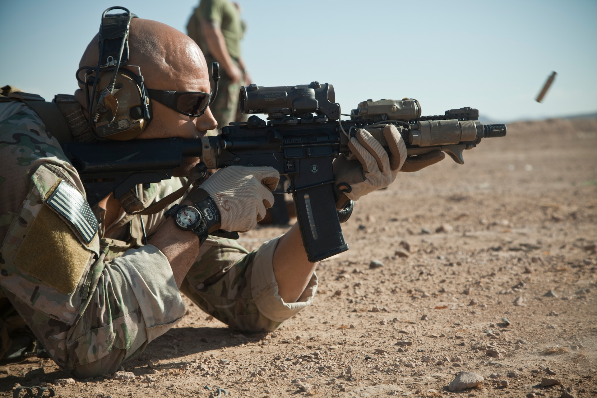 A coalition force member fires his M4 carbine during live fire training on a base in Herat province, Afghanistan, Nov. 9, 2012.