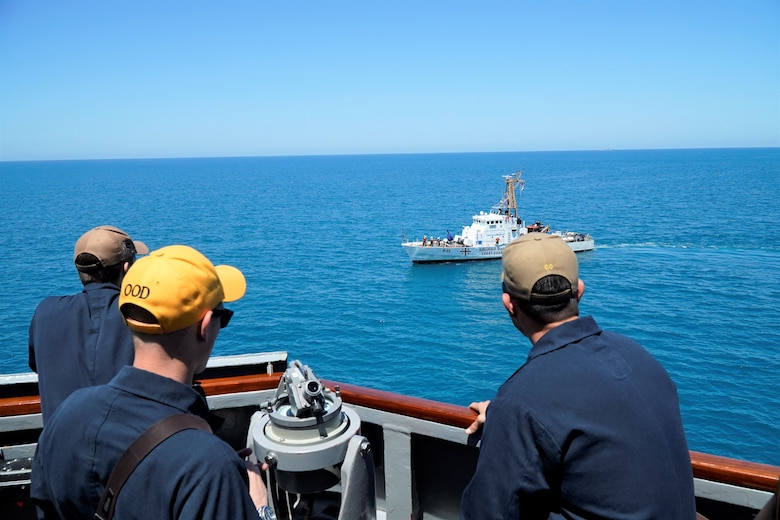 200622-N-NO901-0007 BLACK SEA (June 22, 2020) – Ensign Seamus Long (left), Lt.j.g. Joseph Minicucci (center), and Cmdr. Craig Trent observe USS Porter (DDG 78) and USS Oak Hill (LSD 51) execute maneuvering and air defense exercises with GCG Ochamchire (P-23) and GCG Dioskura (P-25) in the Black Sea, June 22, 2020. Porter, forward-deployed to Rota, Spain, is on its eighth patrol in the U.S. 6th Fleet area of operations in support of U.S. national security interests in Europe and Africa. (U.S. Navy photo by Interior Communication Electrician 2nd Class Jeffrey Abelon/Released)