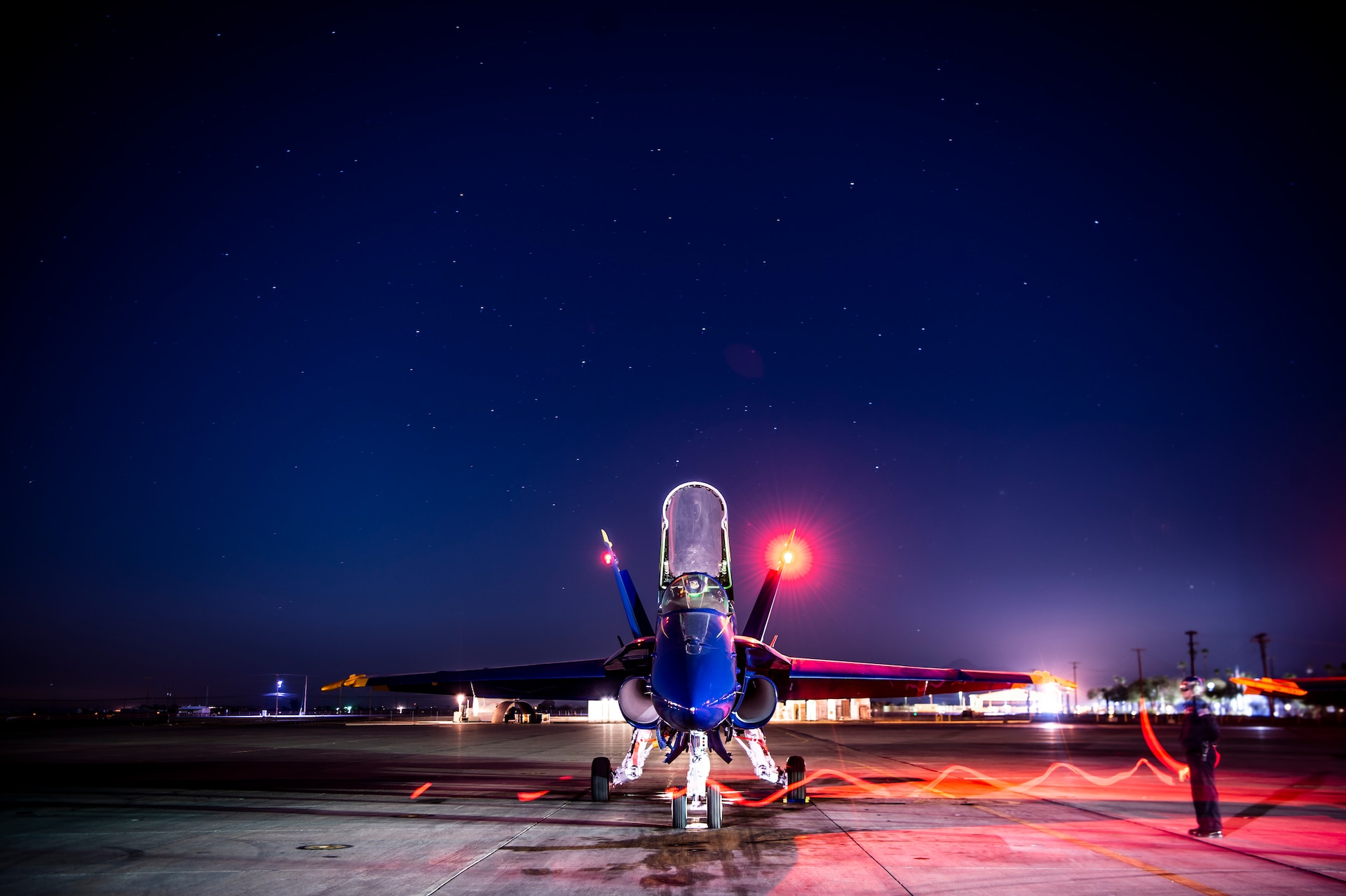 Members of the U.S. Navy Flight Demonstration Squadron, the Blue Angels, perform morning turn-up operations at Naval Air Facility El Centro, California.