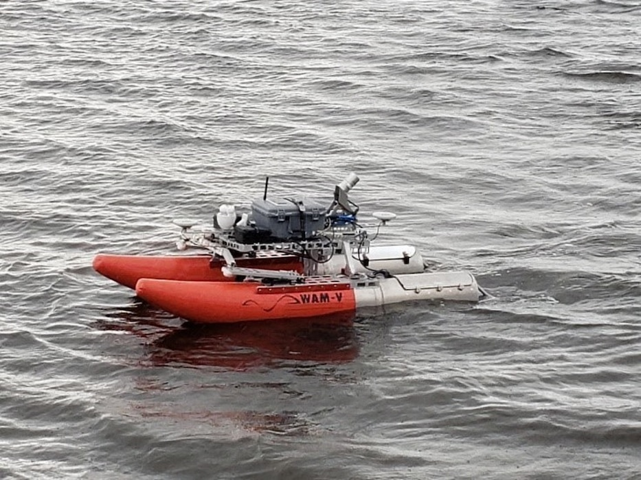 Army's unmanned vessel is used to assess and rehabilitate  waterfront assets. Open water data collection is invaluable for surface and subsurface port management. (Photo credit: John Higgins, U.S. Army)