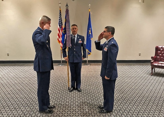 U.S. Air Force Col. Tony England, 17th Mission Support Group commander and Maj. Christopher Higgins, 17th Civil Engineering Squadron incoming commander, salute each other at the 17th CES Assumption of Command ceremony, at the event center on Goodfellow Air Force Base, Texas, June 22, 2020.  The ceremony held less than 10 people to adhere to social distancing and COVID-19 restrictions. (courtesy photo)