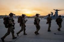 U.S. Marines with U.S. Marine Corps, Special Operations Command prepare to board MV-22B Osprey