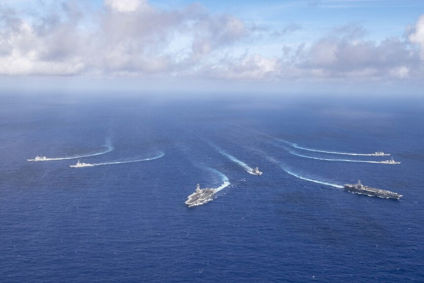 PHILIPPINE SEA (June 23, 2020) The Theodore Roosevelt Carrier Strike Group transits in formation with the Nimitz Carrier Strike Group while conducting dual carrier and airwing operations in the Philippine Sea June 23, 2020. Dual carrier operations unify the tactical power of two individual carrier strike groups, providing fleet commanders with an unmatched, unified credible combat force capable of operating indefinitely. The Nimitz and Theodore Roosevelt carrier strike groups are on scheduled deployments to the Indo-Pacific.