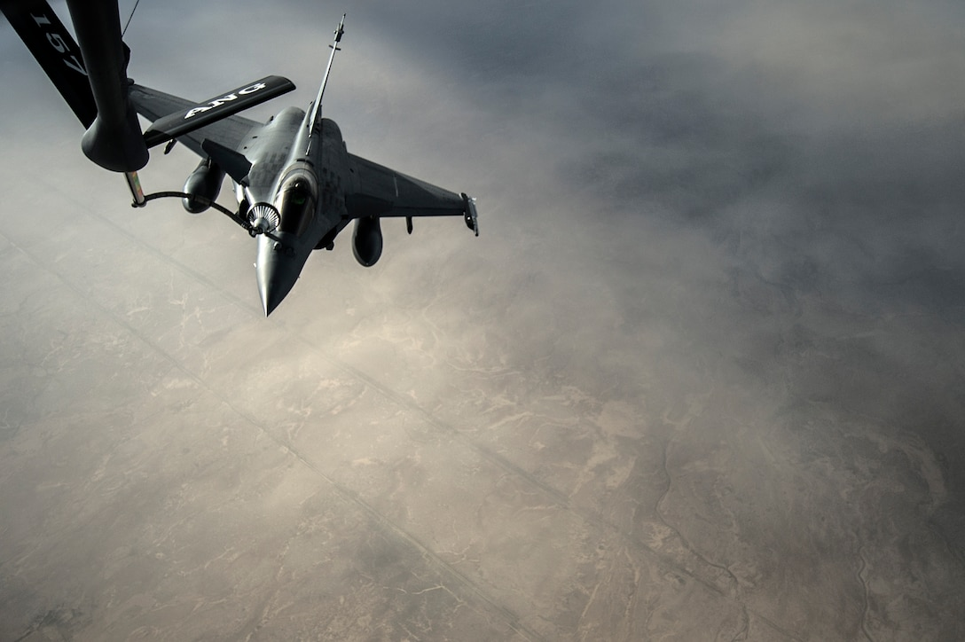 U.S. Air Force Airmen from the 340th Expeditionary Air Refueling Squadron refuel a French F-2 Rafale over Iraq in support of Operation Inherent Resolve, Jan. 8, 2016.
