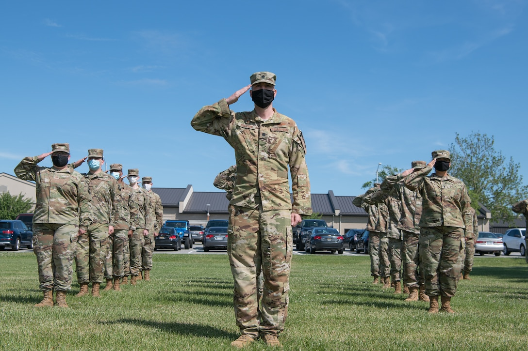 Airmen of the 436th Operations Support Squadron salute during a retreat ceremony June 18, 2020, at Dover Air Force Base, Delaware.