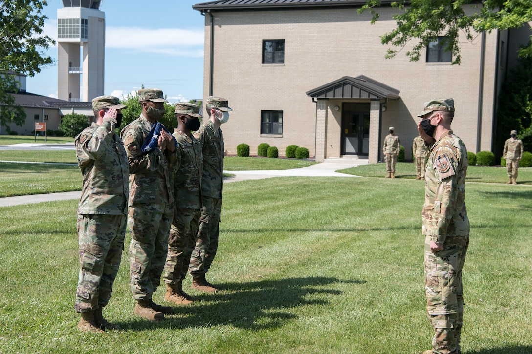 Airmen of the 436th Operations Support Squadron prepare to retire the colors at the conclusion of a retreat ceremony June 18, 2020, at Dover Air Force Base, Delaware. The ceremony is one of the oldest military traditions, dating all the way back to the Revolutionary War. (U.S. Air Force photo by Mauricio Campino)