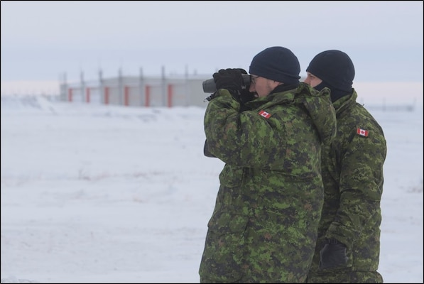Two members of 2 Air Expeditionary Wing evaluate airfield infrastructure to identify a suitable location for a mobile radar system, during their survey visit to Rankin Inlet on January 29, 2020.
