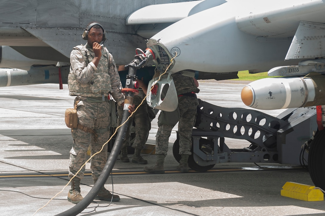 Photo of an Airman fueling an aircraft