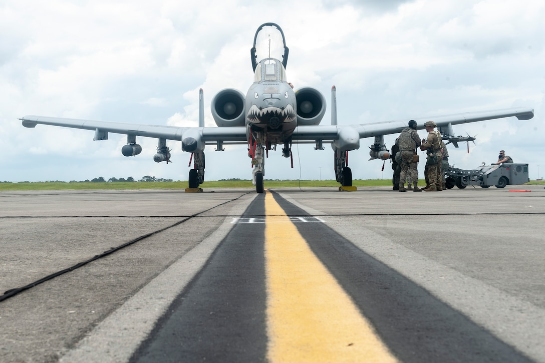 Photo of Airmen preparing to refuel an aircraft