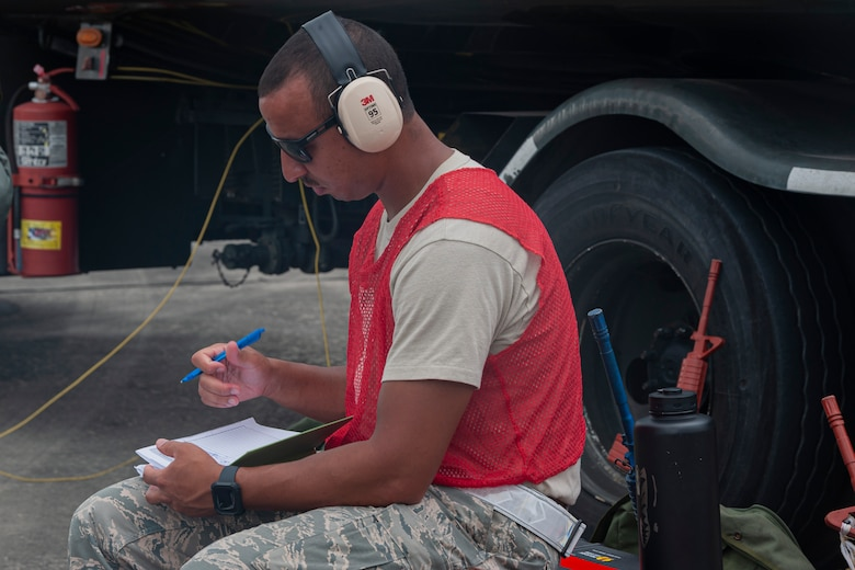 Photo of an Airman taking notes