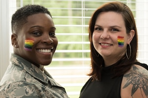 U.S Air Force Master Sgt. Staci Cooper, 131st Operation Support Flight Aviation Resource Management superintendent, and Danie Cooper, Lincoln College Preparatory Academy teacher, stand for a photo on June 10, 2020 at Blue Springs, Missouri. Cooper and her wife married in February 2019 a year after their first date. (U.S Air Force photo by Airman 1st Class Christina Carter)