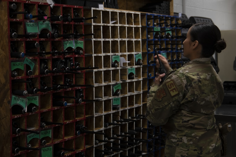 Senior Airman Cindy Argueta, 316th Security Support Squadron armorer, gets a two-way radio for a defender to use during their shift at Joint Base Andrews, Md., June 17, 2020. Radios allow for defenders to communicate with each other and the base defense operations center.