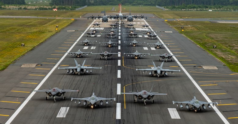 "Twelve U.S. Air Force F-16CM Fighting Falcons, 12 Koku-Jieitai F-35A Lightning II Joint Strike Fighters, two U.S. Navy EA-18G Growlers, a USN C-12 Huron, two USAF MC-130J Commando II aircraft, and a USN P-8 Poseidon participate in an ""Elephant Walk"" at Misawa Air Base, June 22, 2020. The Elephant Walk showcased Misawa Air Base's collective readiness and ability to generate combat airpower at a moment's notice to ensure regional stability throughout the Indo-Pacific. This is Misawa Air Base's first time hosting a bilateral and joint Elephant Walk."