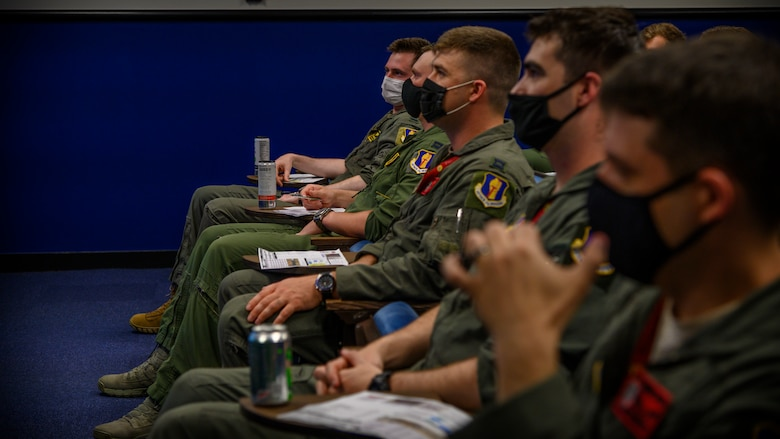 "U.S. Air Force, U.S. Navy and Japanese Air Self- Defense Force pilots attend a brief in preparation for an ""Elephant Walk"" at Misawa Air Base, Japan, June 22, 2020. They participated in the Elephant Walk which showcased Misawa Air Base's collective readiness and ability to generate combat airpower at a moment's notice to ensure regional stability throughout the Indo-Pacific. This is Misawa Air Base's first time hosting a bilateral and joint Elephant Walk."