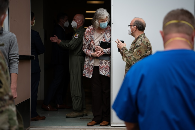 Representatives from state and federal agencies speak to each other outside an entrance at the Memorial Hospital Texas County in Guymon, Oklahoma, during a visit to the hospital, May 15, 2020.