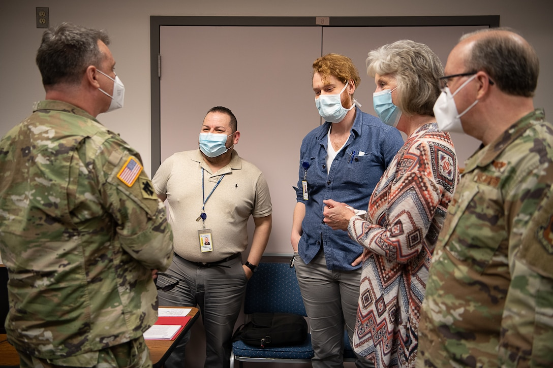 Members of the Oklahoma National Guard meet with employees from the Oklahoma State Department of Health to discuss their partnership at the Texas County Health Department in Guymon, Oklahoma, May 15, 2020.