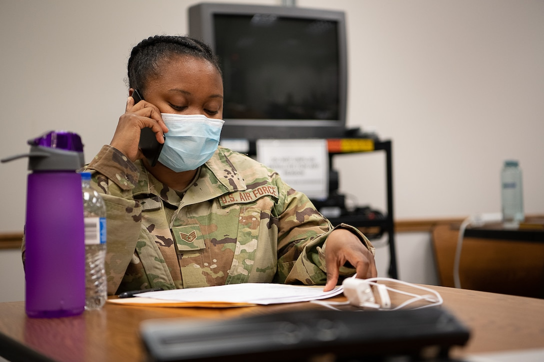 Oklahoma Air National Guard Staff Sgt. Shawntoria Miles, a medic with the 137th Special Operations Medical Group in Oklahoma City, calls an individual as part of contact tracing operations at the the Texas County Health Department in Guymon, Oklahoma, May 15, 2020.