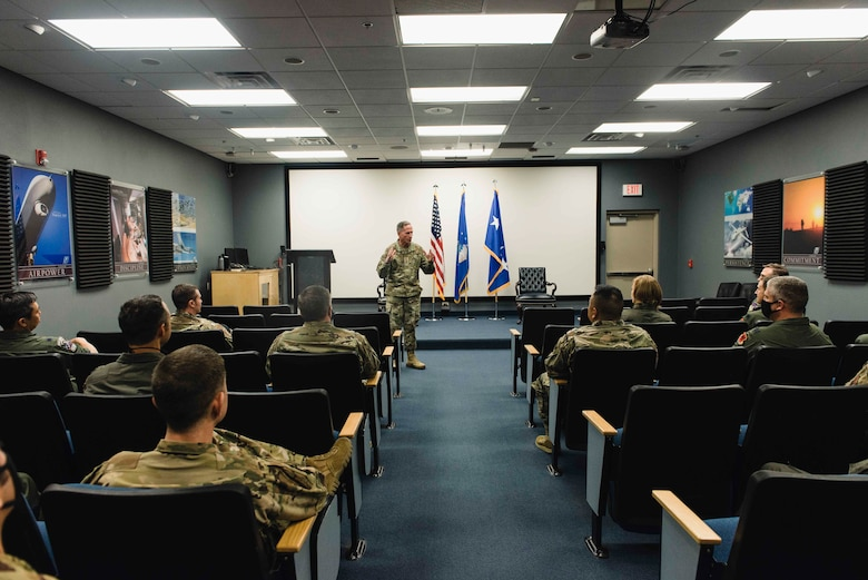 Air Force Chief of Staff Gen. David L. Goldfein speaks to squadron leadership in a meeting room at Creech Air Force Base