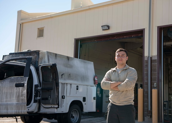 Senior Airman Joshua Meza, 90th Logistics Readiness Squadron, vehicle maintenance technician, stands next to a truck that he found with fire damage, June 23, 2020, on F.E. Warren Air Force Base, Wyoming. When Meza opened the door the fire seamed to all ready be out, and said the fire suppression system did its job well. (U.S. Air Force Photo by Senior Airman Braydon Williams)