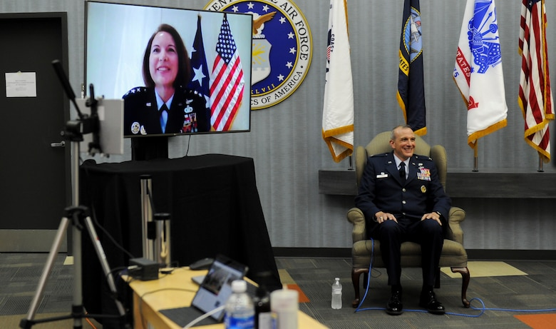 Lt. Gen. Mary O'Brien, Deputy Chief of Staff for Intelligence, Surveillance, Reconnaissance and Cyber Effects Operations, officiates the assumption ceremony for Col. Maurizio D. Calabrese as he takes command of the National Air and Space Intelligence Center June 9, 2020.