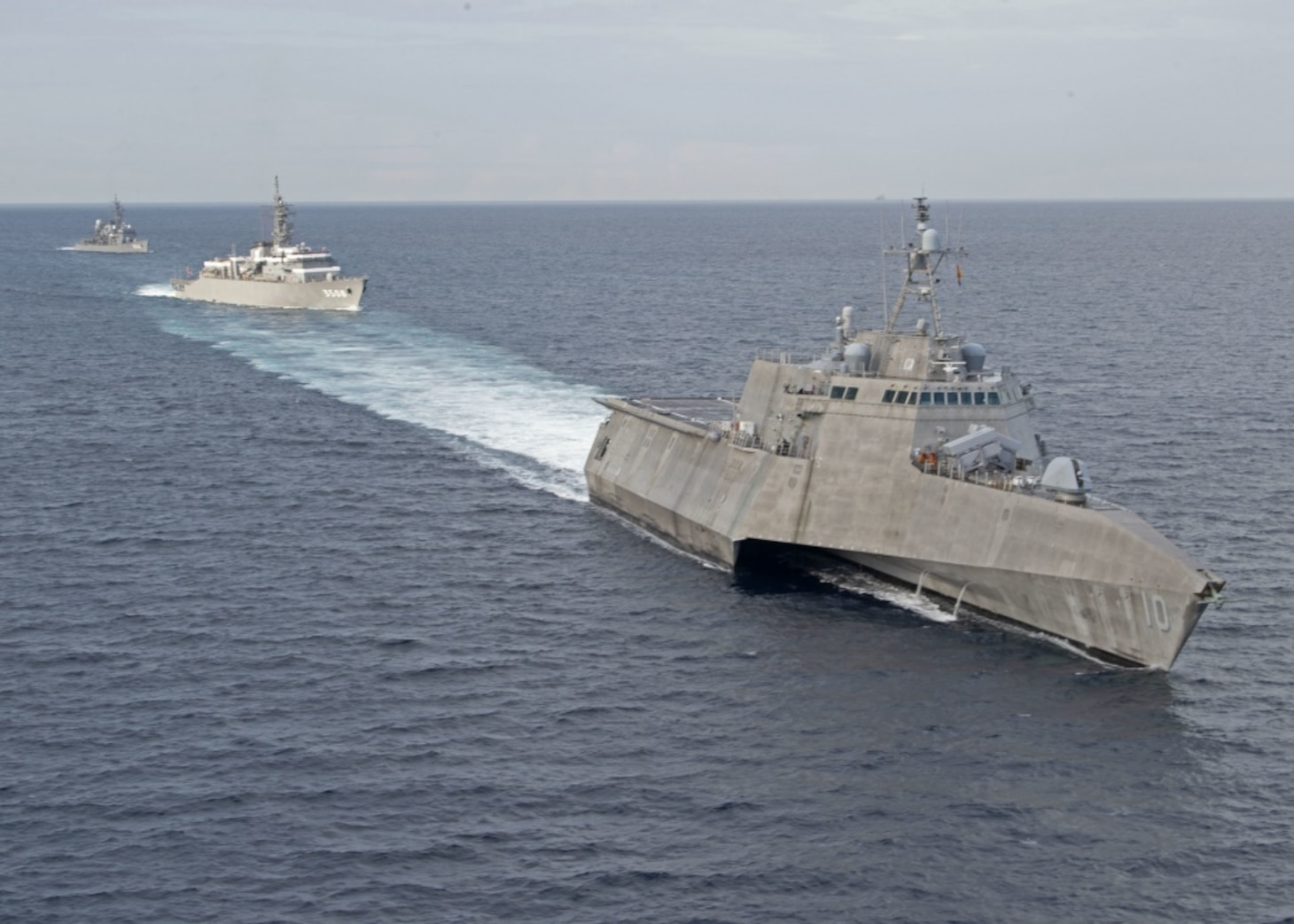 The Independence-variant littoral combat ship USS Gabrielle Giffords (LCS 10), right, exercises with the Japan Maritime Self-Defense Force training ships JS Kashima (TV 3508) and JS Shimayuki (TV 3513) in the South China Sea, June 23, 2020. Gabrielle Giffords, part of Destroyer Squadron Seven, is on a rotational deployment, operating in the U.S. 7th Fleet area of operations to enhance interoperability with partners and serve as a ready-response force.