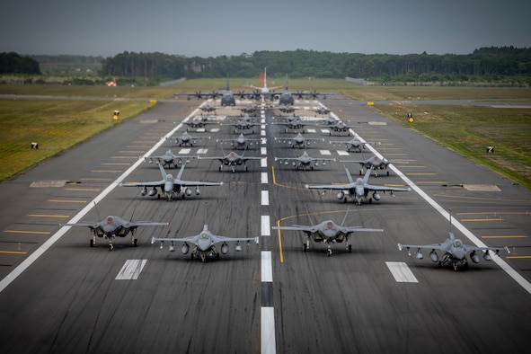 """Twelve U.S. Air Force F-16CM Fighting Falcons, 12 Koku-Jieitai F-35A Lightning II Joint Strike Fighters, two U.S. Navy EA-18G Growlers, a USN C-12 Huron, two USAF MC-130J Commando II aircraft, and a USN P-8 Poseidon participate in an """"Elephant Walk"""" at Misawa Air Base, June 22, 2020. The Elephant Walk showcased Misawa Air Base's collective readiness and ability to generate combat airpower at a moment's notice to ensure regional stability throughout the Indo-Pacific. This is Misawa Air Base's first time hosting a bilateral and joint Elephant Walk. (U.S. Air Force photo by Airman 1st Class China M. Shock)"""