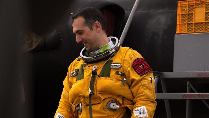Lt. Col Georgescu smiles after receiving a Black Cat patch on his left shoulder that commemorates his 2,000th hour achievement.