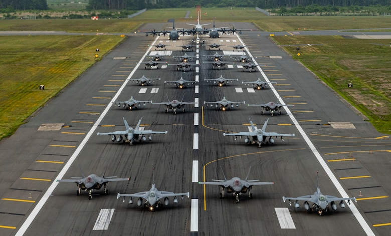 "Twelve U.S. Air Force F-16CM Fighting Falcons, 12 Koku-Jieitai F-35A Lightning II Joint Strike Fighters, two U.S. Navy EA-18G Growlers, a USN C-12 Huron, two USAF MC-130J Commando II aircraft, and a USN P-8 Poseidon participate in an ""Elephant Walk"" at Misawa Air Base, June 22, 2020."