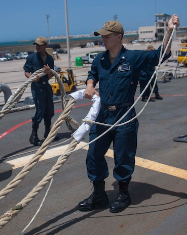 200623-N-KY668-1023 NAVAL STATION ROTA, Spain (June 23, 2020) Information System Technician 2nd Class Ryan T. Pieper heaves around a line on the foc's'le aboard the Arleigh Burke-class guided-missile destroyer USS Roosevelt (DDG 80), June 23, 2020. Roosevelt, forward-deployed to Rota, Spain, is on its first patrol in the U.S. 6th Fleet area of operations in support of regional allies and partners and U.S. national security interests in Europe and Africa. (U.S. Navy photo by Mass Communication Specialist Seaman Austin G. Collins/Released)