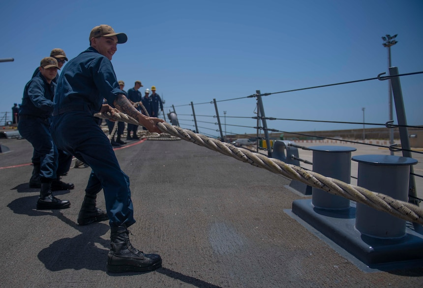 200623-N-KY668-1047 NAVAL STATION ROTA, Spain (June 23, 2020) Operations Specialist Seaman Recruit Mateo C. Betancourt heaves around a line on the foc's'le aboard the Arleigh Burke-class guided-missile destroyer USS Roosevelt (DDG 80), June 23, 2020. Roosevelt, forward-deployed to Rota, Spain, is on its first patrol in the U.S. 6th Fleet area of operations in support of regional allies and partners and U.S. national security interests in Europe and Africa. (U.S. Navy photo by Mass Communication Specialist Seaman Austin G. Collins/Released)
