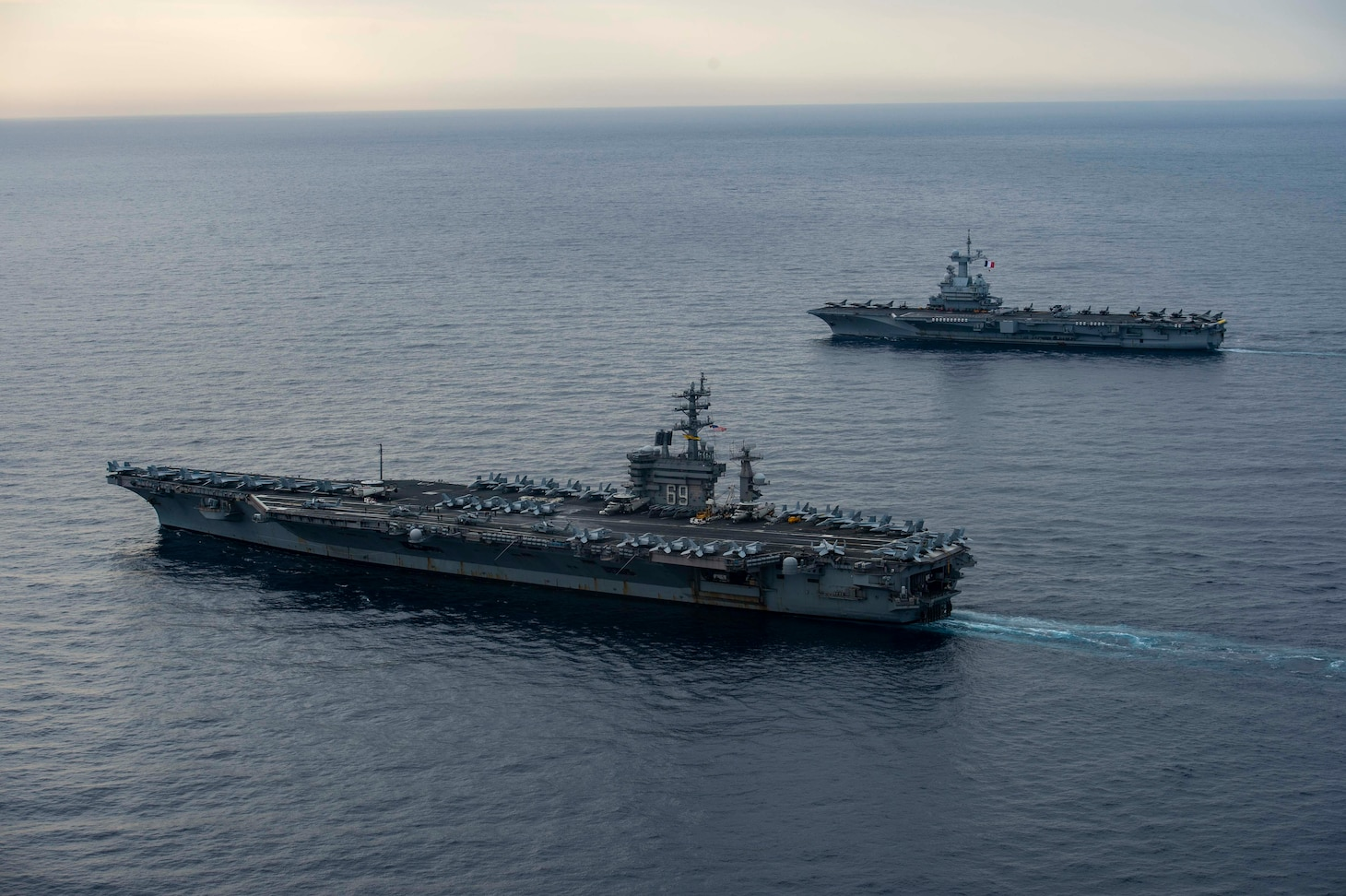 MEDITERRANEAN SEA (March 3, 2020) The aircraft carrier USS Dwight D. Eisenhower (CVN 69), left, and the French aircraft carrier FS Charles de Gaulle (R91) sail in formation. Ike is conducting operations in the Mediterranean Sea as part of the USS Dwight D. Eisenhower Carrier Strike Group.