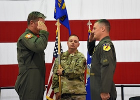 Lt. Col. Aaron Palan Salutes Col. Stephen Nester after accepting command of the 358th Fighter Squadron.