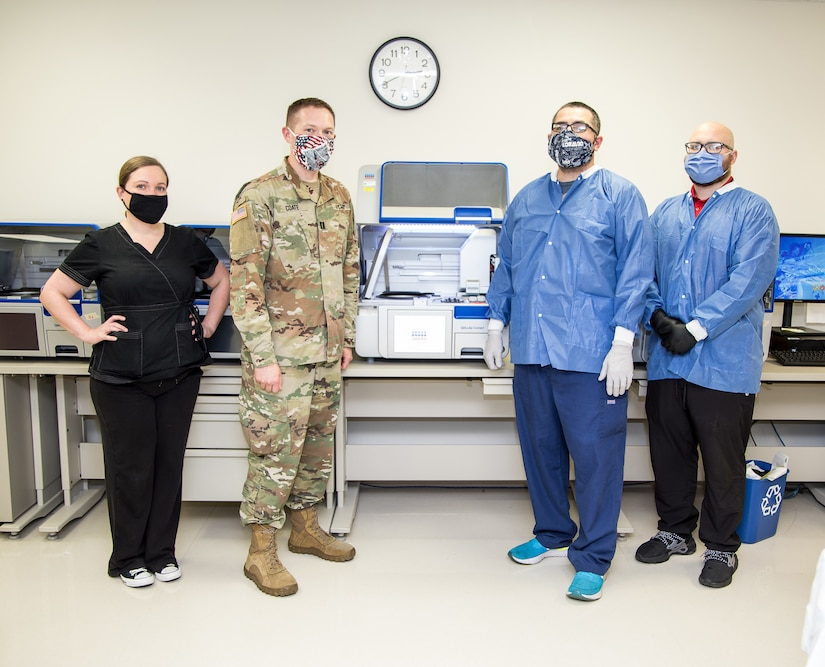 Molecular team members at Brooke Army Medical Center demonstrate molecular ribonucleic acid extraction equipment.