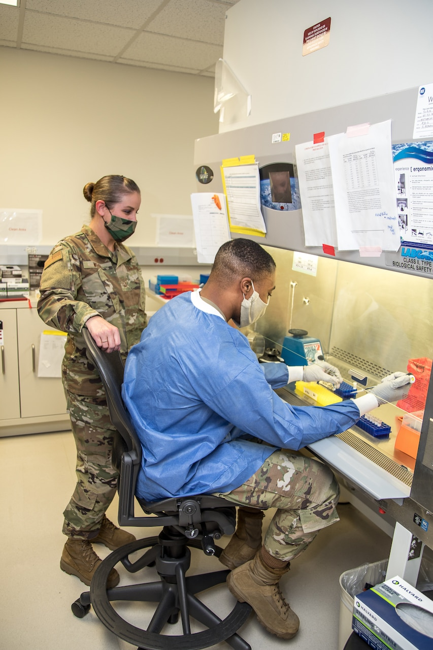Airmen prepare patient samples for COVID-19 extraction.