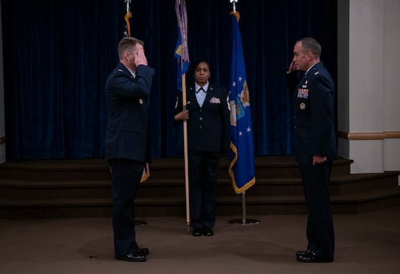 Colonel Peter Bonetti, 90th Missile Wing commander, salutes, Colonel Paul Toth, 90th Medical Group incoming commander, as he assumes command of the 90th MDG during a change of command ceremony June, 23, 2020, on F.E. Warren Air Force Base, Wyo. A change of command ceremony is a tradition that represents a formal transfer of authority and responsibility from the outgoing commander to the incoming commander. (U.S. Air Force photo by Senior Airman Abbigayle Williams)