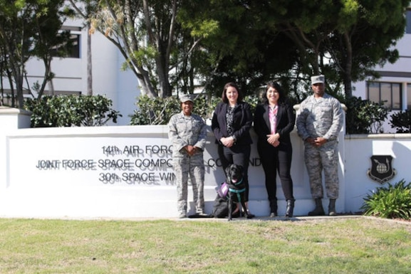 Members of the 30th Space Wing Sexual Assault Prevention and Response team pose for a photo Feb. 13, 2019, at Vandenberg Air Force Base, California. The 30th SAPR team is comprised of two coordinators, one lead victim advocate, and a courthouse facility dog along with 20 volunteer victim advocates. Their innovation and support led the SAPR team to win the 2019 Department of the Air Force Exceptional SAPR Team Award. (Courtesy photo)