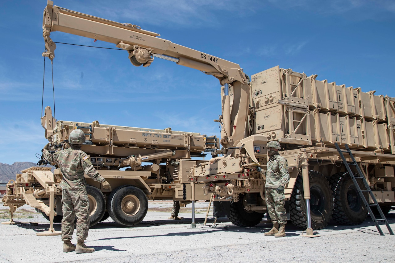 Soldiers prepare a Patriot missile system.